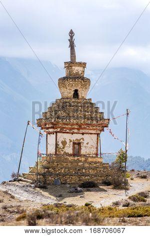 Traditional old Buddhist stupa in mountains of Nepal. Annapurna Circuit Trek