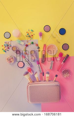 Colorful make up products with pursue pop art flat lay scene, retro toned