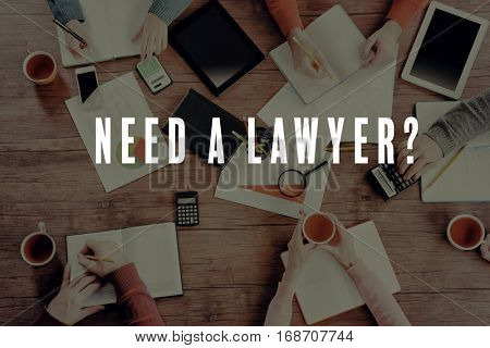 People working at office. Text NEED A LAWYER? on background