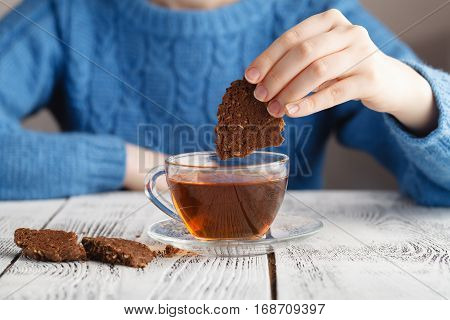Girl Dunk Biscuits In Tea