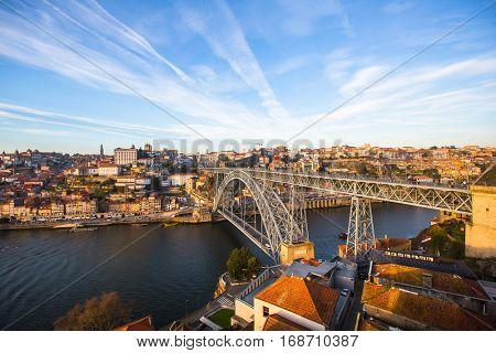 View of Douro river, Ribeira and Dom Luis I bridge, Porto, Portugal.