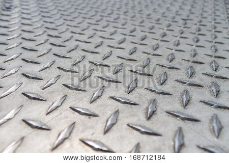 Diamond plate pattern close up at angle with depth of field