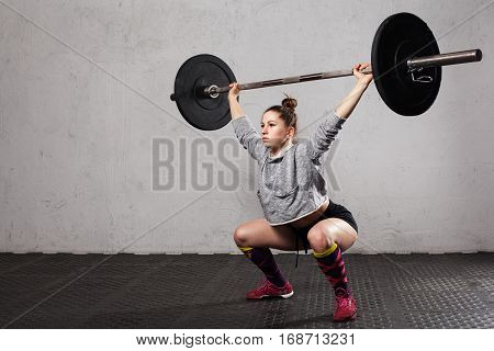 Woman Doing A Overhead Squat