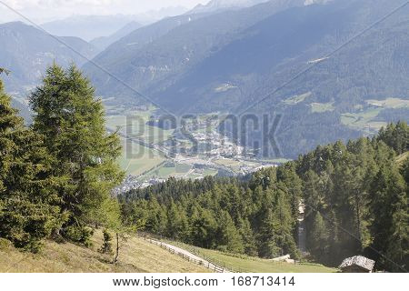 Aerial view from the cable car from the mountains of the Alps in Italy