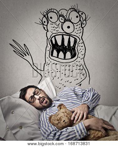 Man sleeping with teddy bear having nightmares