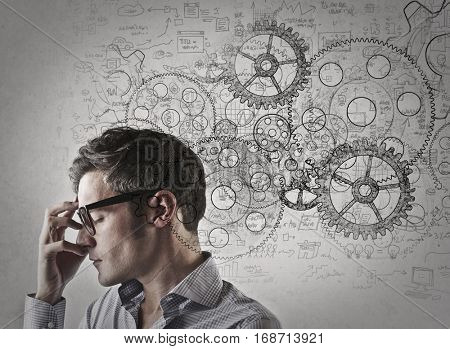Serious man with glasses thinking very hard