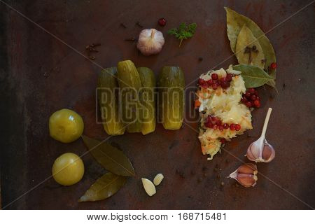 Pickles. Bowl of pickled gherkins cucumbers over rustic wooden background with copy space.