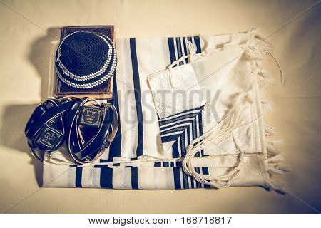 Jewish ritual objects Talit with hebrew inscription: And brought us to Zion in joy. Kippah Tefillin with a hebrew inscription: The arm tefillin and The head tefillin and Siddur - jewish prayer book