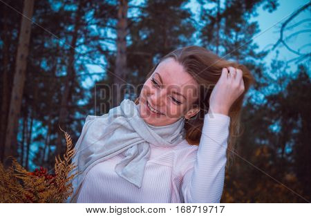 Pretty girl enjoying herself in the forest expressing happiness or freedom