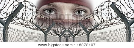 Fence with a barbed wire and veiled face. Conceptual image - human rights concept poster