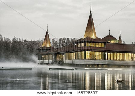 Heviz spa at night. Lake Heviz is the 2nd largest natural thermal lake in the world. (HDR image with black gold filter)