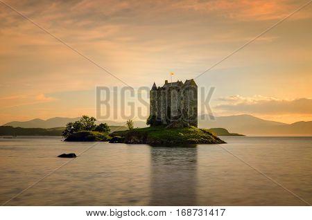 Stalker Castle in yellow evening light Highlands Scotland