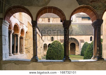 Brixen Italy - December 26 2016: Arched windows of cathedral cloister famous for depicting scenes of the Bible.
