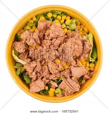 top view of a yellow bowl of tuna fish salad isolated on white background