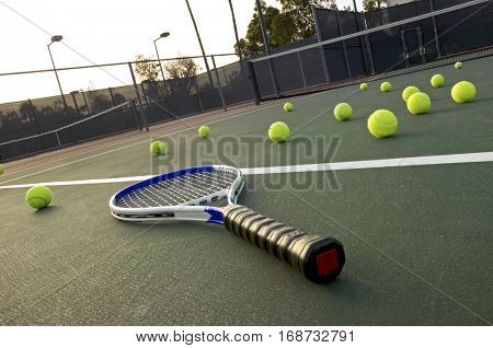 Tennis Racket and Balls on Court