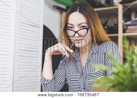 Sensual Asian Girl At Workplace