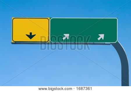 Blank Freeway Sign On Blue Skies