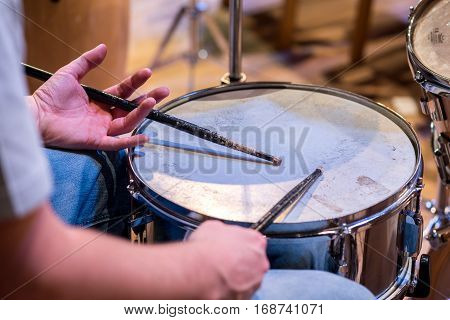 Close view on the drummer playing the drum