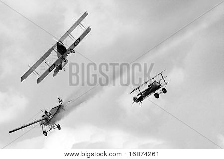 Historic planes dogfight on the sky.Vintage style photography. WW1 scene. All planes are homemade radio control models.