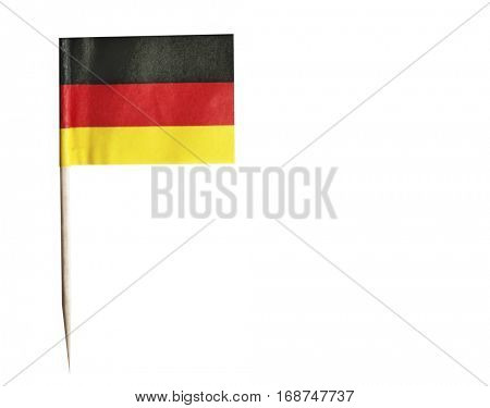 German flag in toothpick against white background