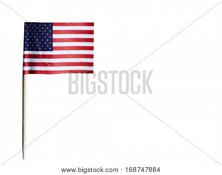 American flag in toothpick against white background