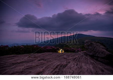Hikers Descend Jane Bald at Civil Twilight with purple sunset lingering over mountain