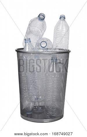 Empty bottles in garbage bin over white background
