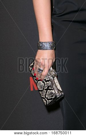 Jodie Sweetin (purse closeup) arrives at the Weinstein Company and Netflix 2017 Golden Globes After Party on Sunday, January 8, 2017 at the Beverly Hilton Hotel in Beverly Hills, CA.