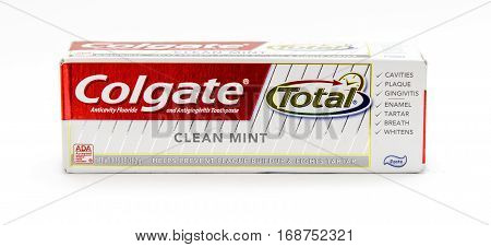 New York January 25 2017: A packaged travel size tube of Colgate toothpaste against white background.