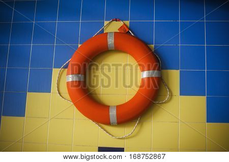 life preserver hanging on the wall in the pool