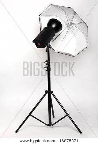 Studio flash with big octagonal soft-box isolated on a white background.