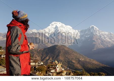 Side View Of Male Tourist Standing On Top Of Cliff With Calabash Gourd In His Hands, Enjoying Fresh