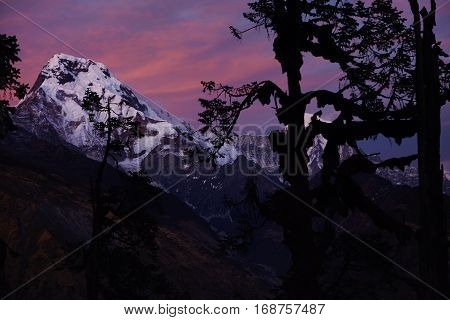 Beauty And Grandeur Of Wild Nature. Gorgeous Red And Blue Morning Sky Over Snowy Summits And Passes