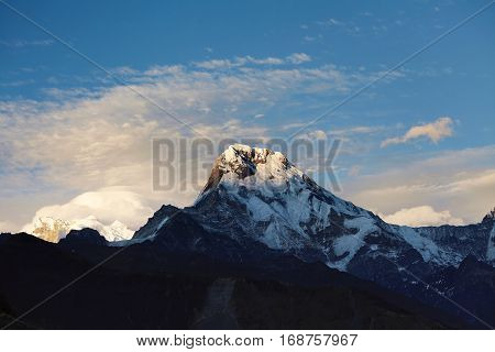 Beautiful Landscape Of Ancient Gigantic Mountains With Snow Capped Summits And Passes Standing High