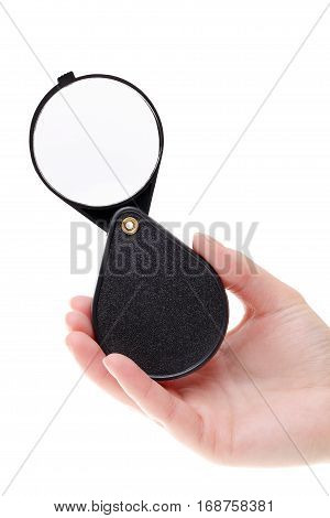 Hand holding folding magnifier loupe isolated on white, hand holding