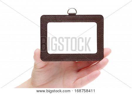 Hand holding blank identification badge isolated on white background