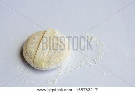 powder puff brush on the white background