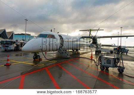 Riga, Latvia - November 25. 2016: Aircrafts of low cost airline company Air Baltic in Riga Airport at day time