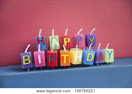 Unlit birthday candles over colored background