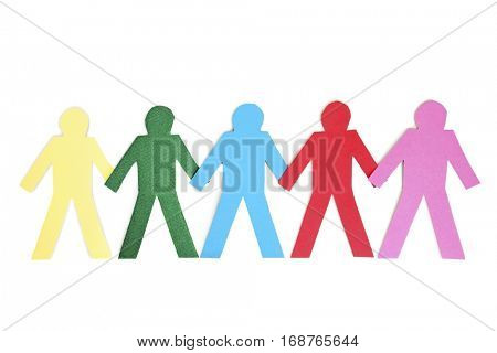 Row of multi-coloured paper cut out figures over white background