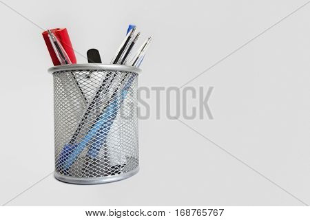 Close-up view of a pen holder over white background