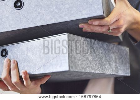 Close-up view of businesswoman holding box file