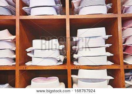 Folded shirts on clothes rack