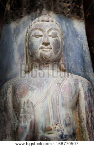 Stock Photo - buddha  old wood statue