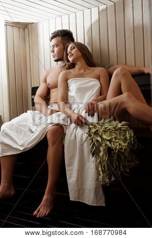 Young romantic couple in love  enjoying steam bath in spa centre