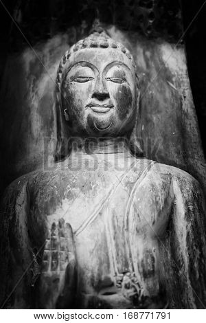 Stock Photo - old Buddha statue black and white color
