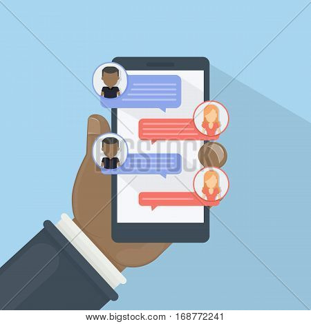 Chat via smartphone. African american hand holds phone with chat bubbles on the screen. Social networking.