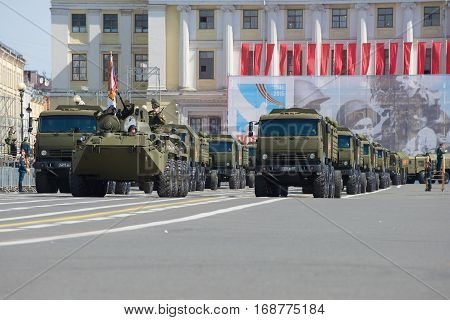SAINT PETERSBURG, RUSSIA - MAY 05, 2015: Convoy of military equipment on Palace square. Rehearsal of parade in honor of Victory Day