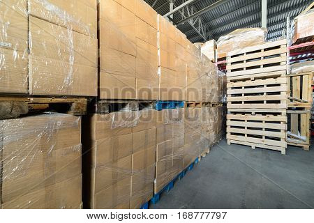 Warehouse transport and logistics company. Pallets with boxes of cardboard. Cardboard boxes wrapped in stretch film.