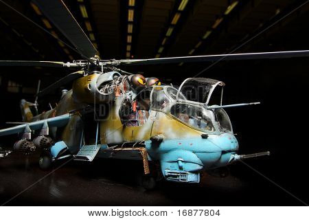 Battle helicopter in hangar (scale-model 1:24 scale). Marking is fictive. Close up with shallow DOF.